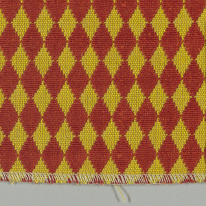 Double cloth in a red and gold diamond pattern. Warp threads are red and yellow. Weft threads are orange and dark yellow.