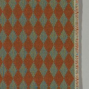 Double cloth in a dark orange and blue diamond pattern. Warp threads are brown and beige. Weft threads are blue and orange.