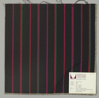 Warp-faced twill weave in vertical stripes of black alternating with narrow stripes of green, violet and red-orange.