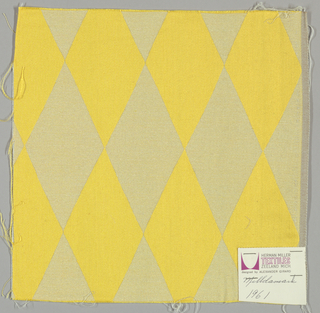 Damask with geometric patterning in yellow and white.