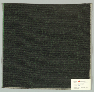 Warp-faced plain weave in black and green. Warp is comprised of black threads while the weft is made up of heavy green yarns. Number 252.