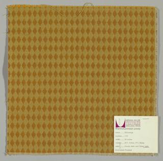 Double cloth in a dark yellow and orange diamond pattern. Warp threads are yellow-orange and beige. Weft threads are beige and dark brown.