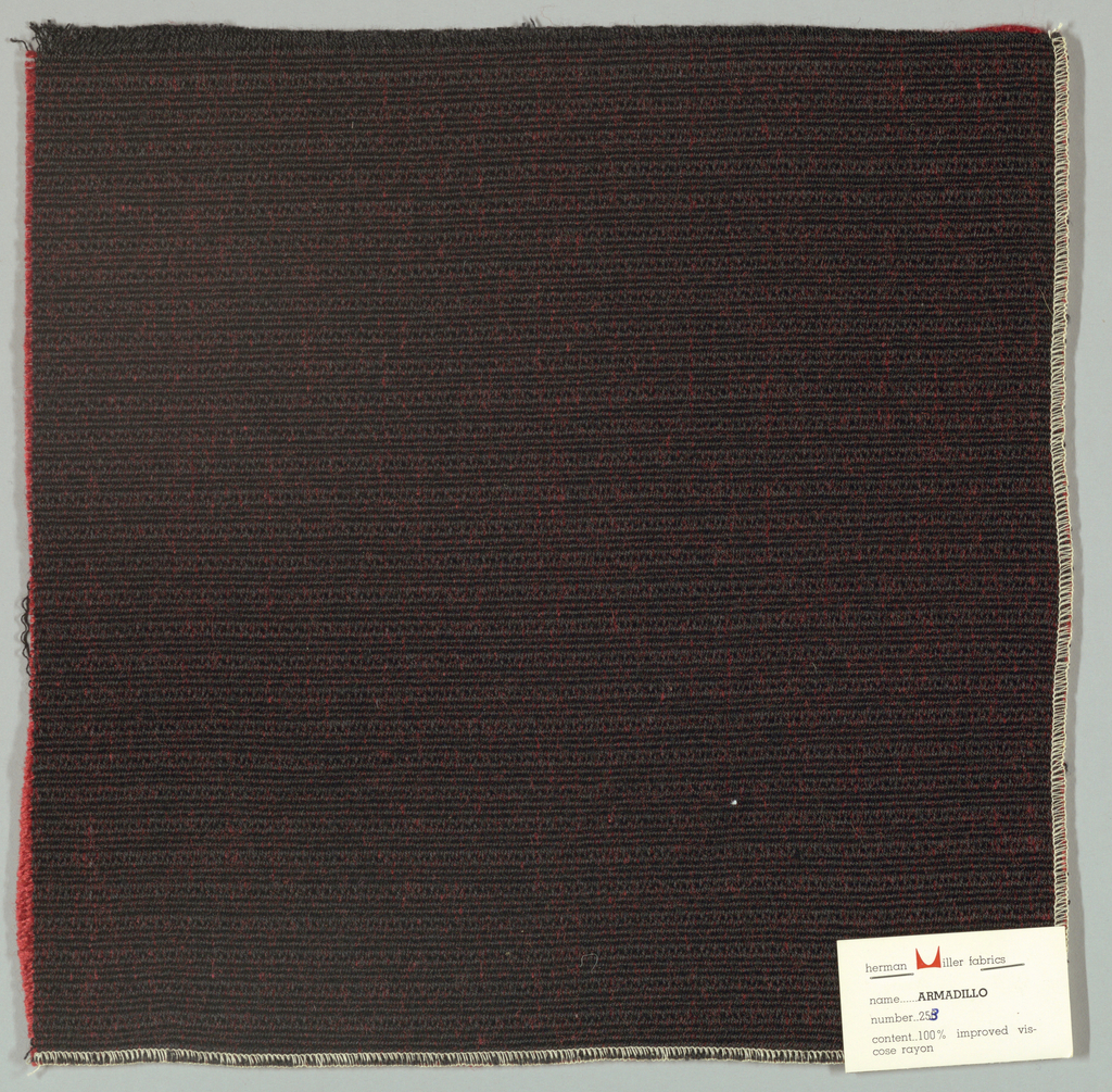Warp-faced plain weave in black and red. Warp is comprised of black threads while the weft is made up of heavy red yarns. Number 253.