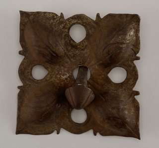 Square type, pierced and embossed with wrought lines. Quadrant leaf design based on old examples. Five notched mushroom-head nail with square shank.