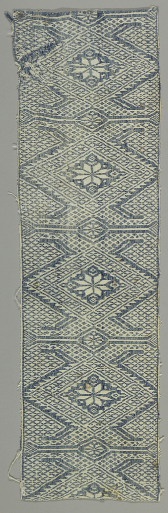 Supplementary weft floating alternatively face to face forming a design of lozenges. Of a fabric type known as Perugia towels.