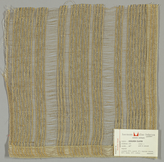 Plain and gauze weave in beige and orange with metallic gold threads. Orange warps threads are gauze woven while the metallic gold warp threads are plain woven. Weft is comprised of beige threads.