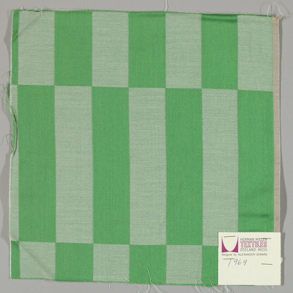 Damask with geometric patterning in green and white.