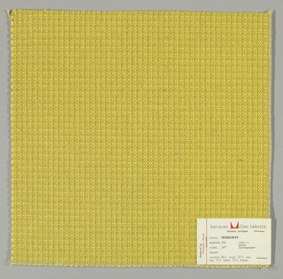 Textured plain weave in yellow. Warp is comprised of heavy yarns and shiny threads in yellow. Weft is comprised of thick and thin yarns in yellow.