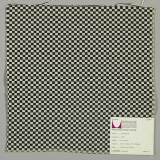 Double cloth in a small-patterned black and white checkerboard. Warp and weft threads are black and white.