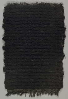Black fabric. Yarns create a textured surface.