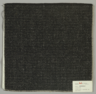 Warp-faced plain weave in black and white. Warp is comprised of black threads while the weft is made up of heavy white yarns. Number 250.