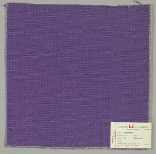Textured plain weave in violet. Warp is comprised of heavy yarns and shiny threads in violet. Weft is comprised of thick and thin yarns in violet.