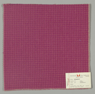 Textured plain weave in magenta. Warp is comprised of heavy yarns and shiny threads in magenta. Weft is comprised of thick and thin yarns in magenta.