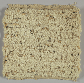 Textured, natural colored reversible rug.