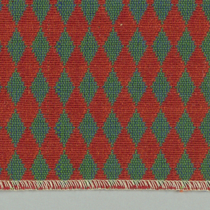 Double cloth in a red and blue-green diamond pattern. Warp threads are red and green. Weft threads are orange and blue.