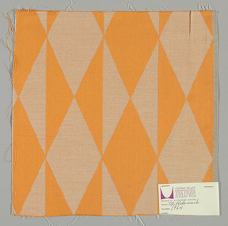 Damask with geometric patterning in orange and white.