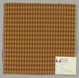 Double cloth in a dark orange and dark yellow diamond pattern. Warp threads are beige and dark yellow. Weft threads are orange and dark yellow.