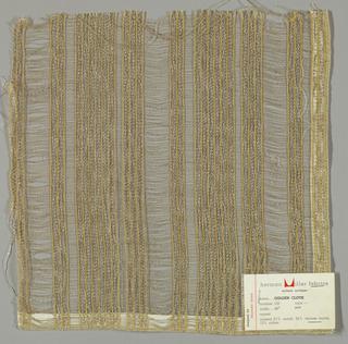 Plain and gauze weave in beige and orange with metallic gold threads. Orange warps threads are gauze woven while the metallic gold warp threads are plain woven. Weft is comprised of beige threads.