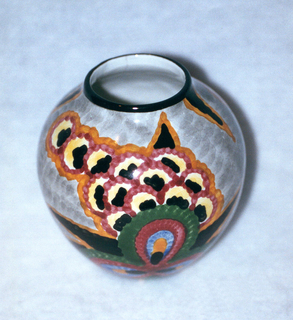 Circular, bulbous body widest in the middle narrowing to the black-lined top edge.  Gray background with surface patterning of stylized flowers in black, orange, blue, burgundy, and green; circular blooms in black, yellow, burgundy, and orange; and finally black leaves outlined in orange.  The interior is glazed white.