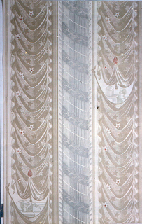 Drapery and column striped pattern. Drapery swags, printed in beige, run vertically along either edge, containing stars and red finial. Below finial is a gap in drapery, which contains womans hat on stand. Gray column runs down center of design.