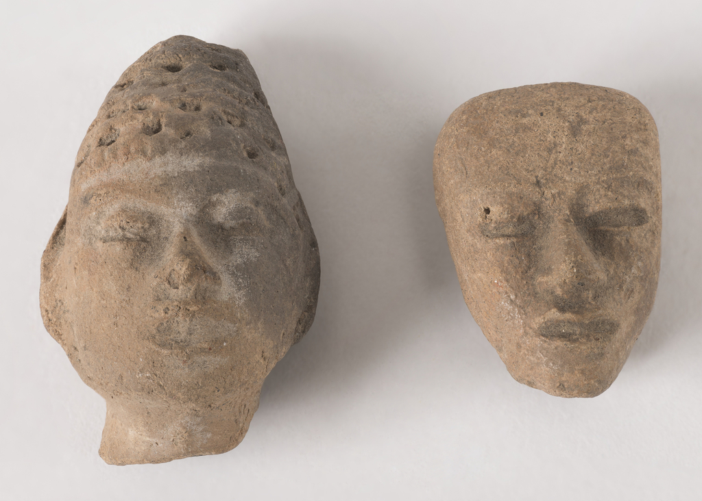 -1a) Head with pointed headdress; back slightly concave. -1b) Mask-like head, squared off at top