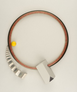 Circular collar with folded radial element of silver topped by a circular yellow orb left of center and faceted rectangle at center.