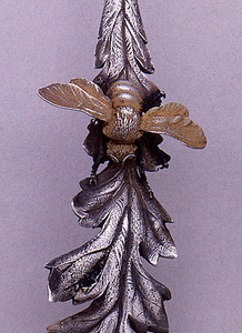Dessert fork with handle in the form of a gilded bee on a  leaf.
