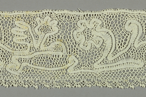 Milanese type of folk lace with scrolls, leaves and sprays. Pattern is made with continuous tape and added net.