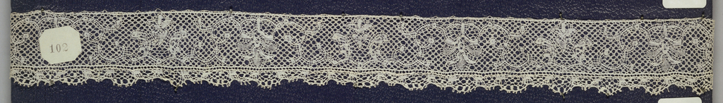 Bobbin lace pillow border, floral scrolls; mid-18th century Flemish.