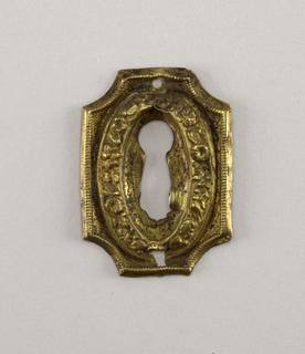Rectangular, with concave circular corners; shaped keyhole in oval reserve.