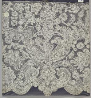 Bobbin lace flounce, symmetrical floral forms in brackets; 18th century Brussels bobbin lace