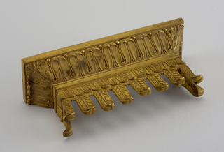 Architectural or funiture cornice with lapped tongue decoration of acanthus corners over frieze of pendant tongues over cut-out with laurel decoration