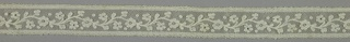 Valenciennes style lace band worked with a floral design and conventional borders.
