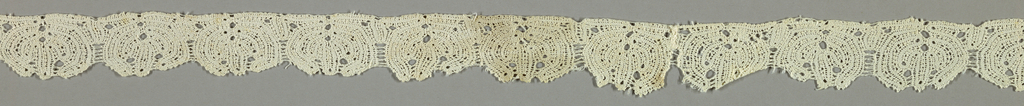 Band of peasant lace with rounded points in design using continuous tape.