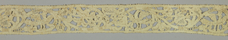 Border with a serpentine floral pattern containing birds and pierced hearts, outlined in relief.