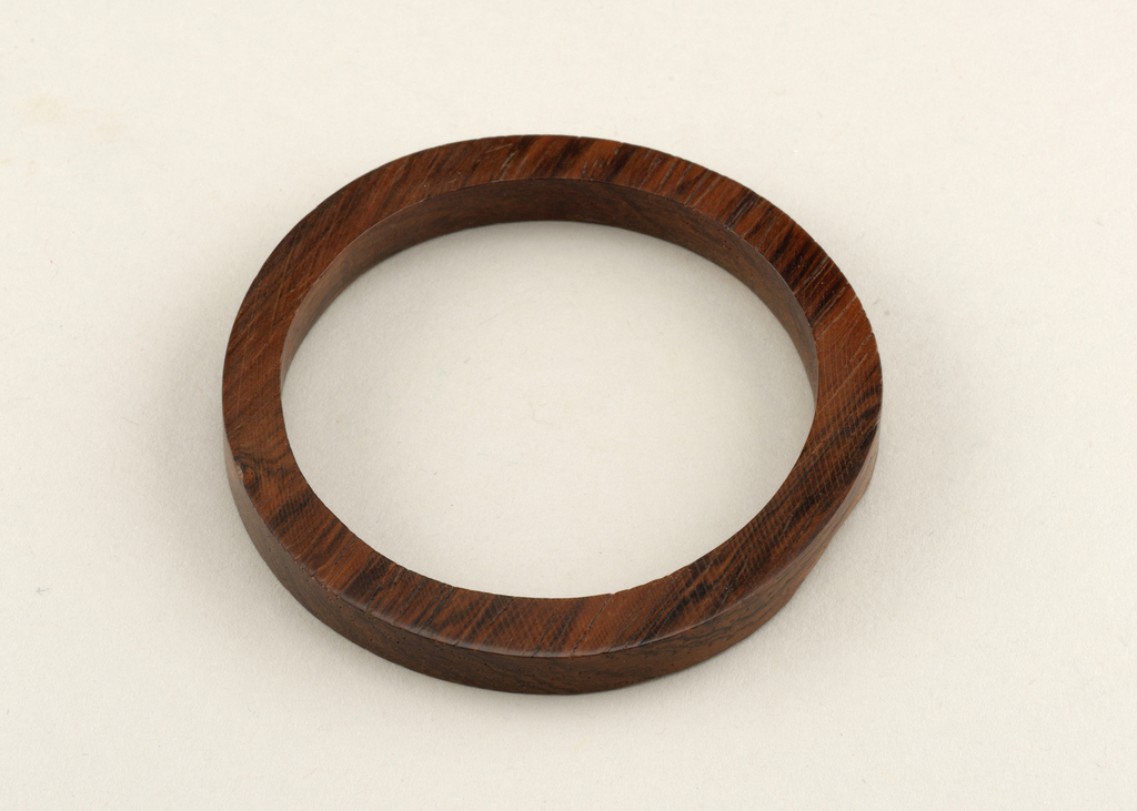 Brown circular form with slightly irregular contours.