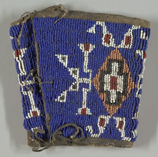 Arm band of hide, beaded in a geometric pattern.