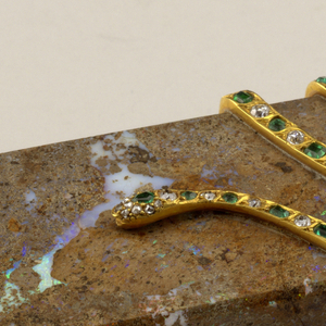 Box, oblong with rounded ends; cut from opal matrix with applied gold serpent set with emeralds and diamonds.