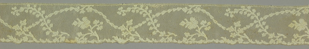 Border patterned with a garland intersected at intervals by floral sprays.