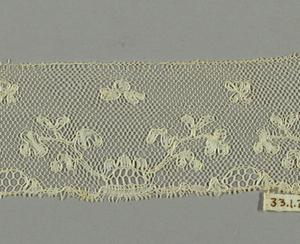 Fragment showing a sprig pattern.