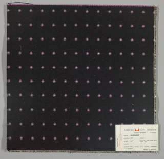 Warp-faced twill in black with supplementary warp patterning used to create grey and pink dots with white centers. Number 347.