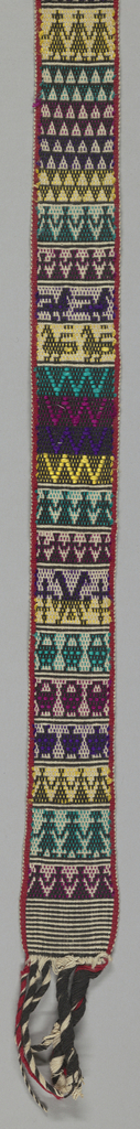 Narrow woven band, probably belt, with various horizontal patterns of animals and birds, people hand-in-hand, and geometric forms in various colors and black. Five tassels at one end, from warp.