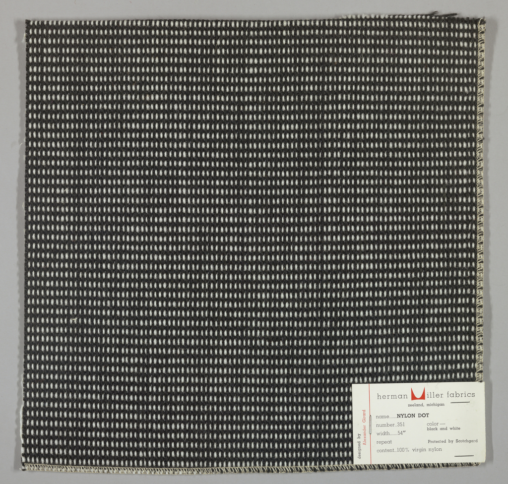 """Plain weave in black and white with every third weft doubled. Warp contains supplementary binding warps. White warp yarns create """"dot"""" effect. Number 351."""