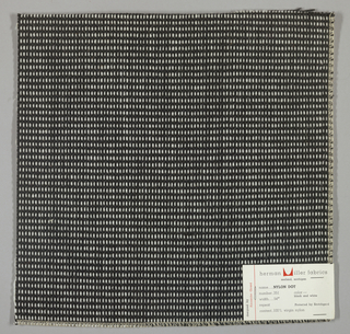 "Plain weave in black and white with every third weft doubled. Warp contains supplementary binding warps. White warp yarns create ""dot"" effect. Number 351."