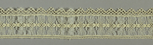 "Lace band made in imitation of withdrawn element work. Component ""a"" is straight edged while Component ""b"" has one scalloped edge."