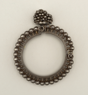 """Hinged braclet with pin fastening. Bracelet is ornamented with a double row of balls set on short stems, smaller balls cover the clasp. Initials on inside: """"A G R - M C M"""""""