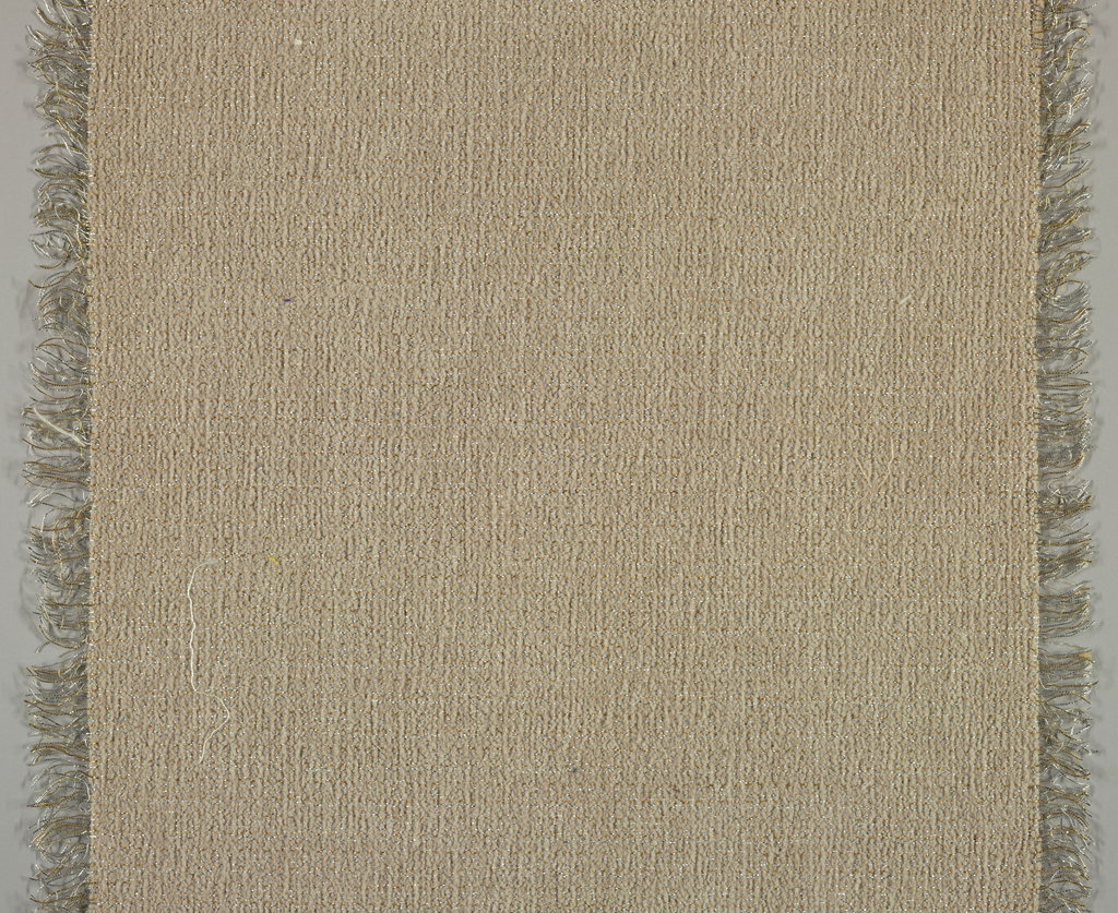 Length of upholstery fabric with one plain selvage, metal warp, chenille weft.