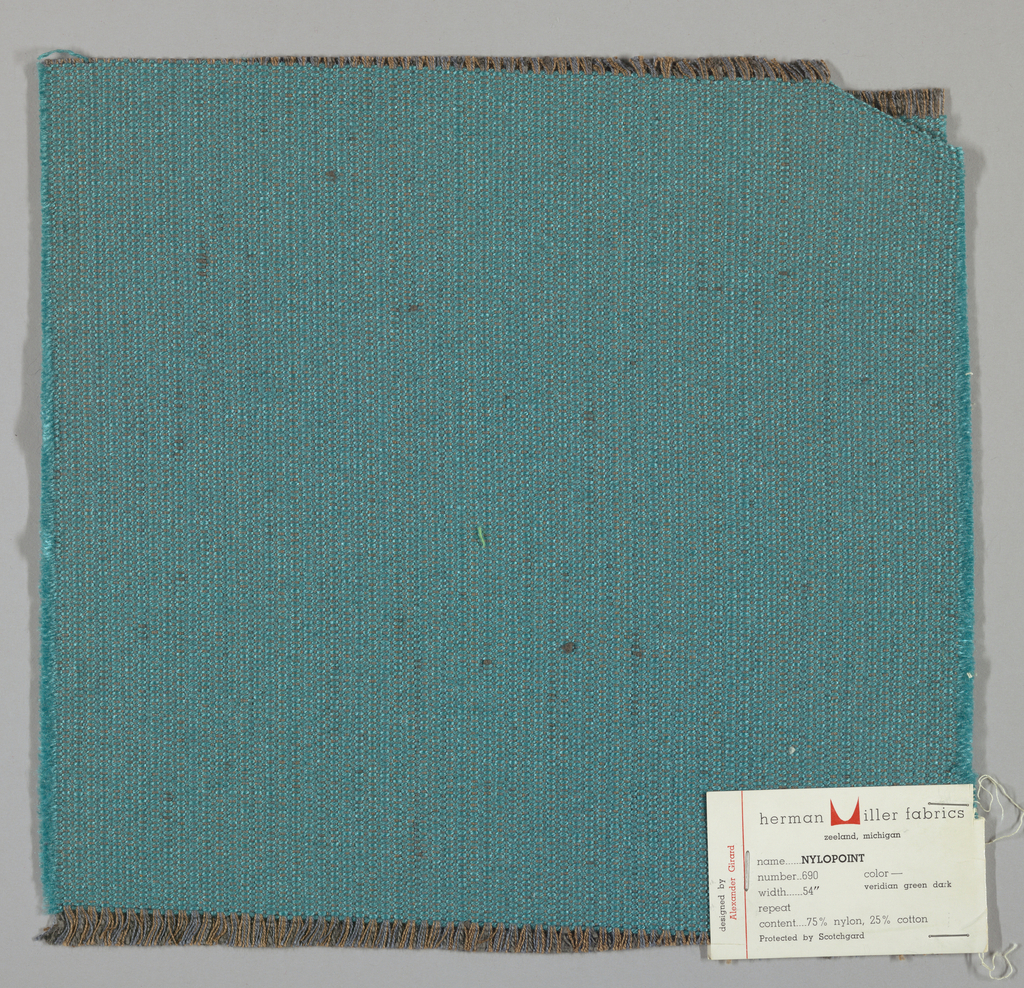 Weft-faced plain weave with doubled warps in overall blue-green color. The weft consists of heavy blue-green yarns. The doubled warps are comprised of fine threads in blue and brown. Number 690.