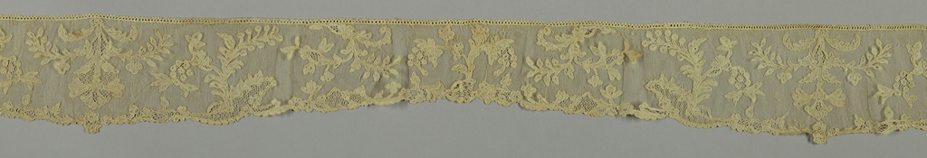 Alencon style lace with simple floral sprays.