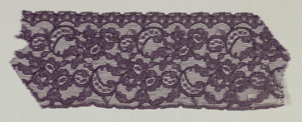 Purple lace fragment showing a continuous floral pattern.